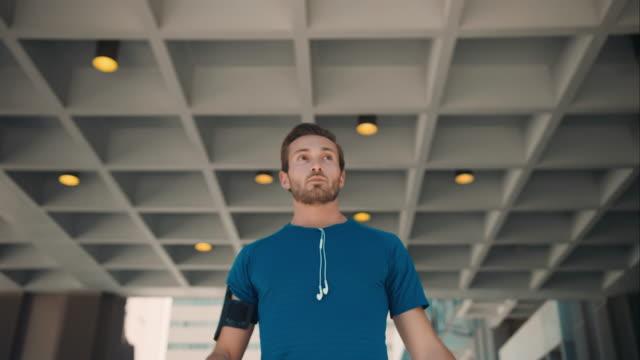 Man starts jogging in urban setting