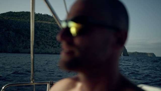 man steers the yacht. - team captain stock videos & royalty-free footage