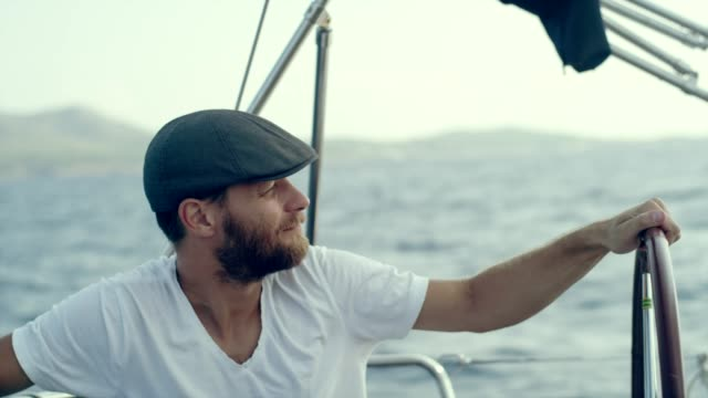 man steers yacht - captain stock videos & royalty-free footage