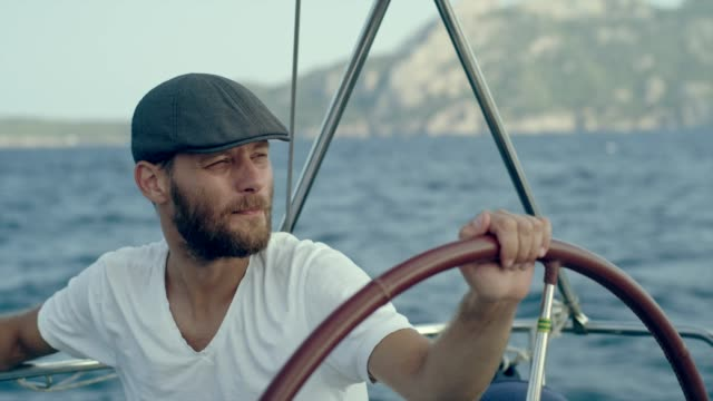 man steers yacht - team captain stock videos & royalty-free footage