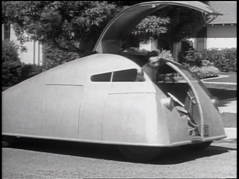 b/w 1935 man stepping out of futuristic car + opening futuristic trailer / guadalupe, ca - prelinger archive stock videos and b-roll footage