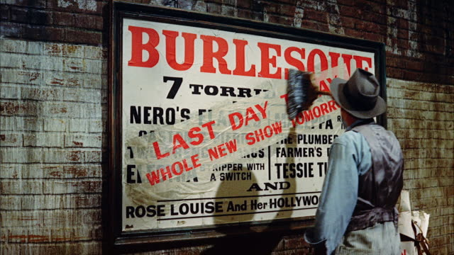 ms man sticking last day today sign poster on  burlesque theater billboard  - glue stock videos and b-roll footage