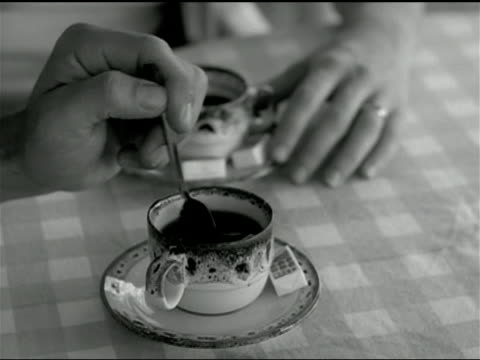 a man stirs a cup of espresso. - espresso stock videos & royalty-free footage