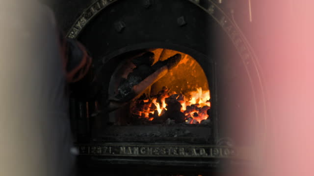 a man stokes a victorian furnace - 19th century stock videos & royalty-free footage