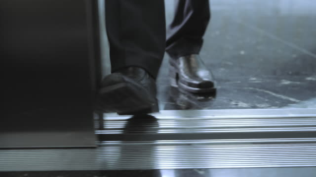 DS Man stops the elevator door with his foot and enters