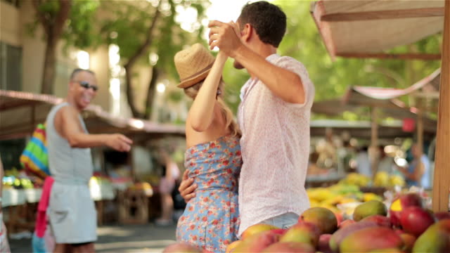 Man stops to watch as cute Brazilian couple dance in open marketplace