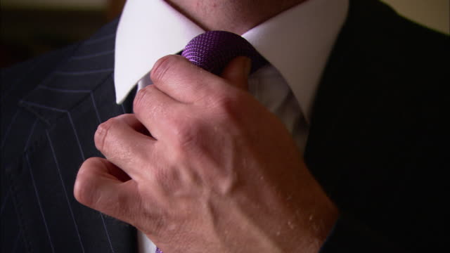 vídeos y material grabado en eventos de stock de a man straightens his tie. - corbata
