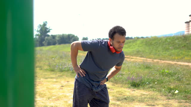 man stretching and warming up before training - hip stock videos & royalty-free footage