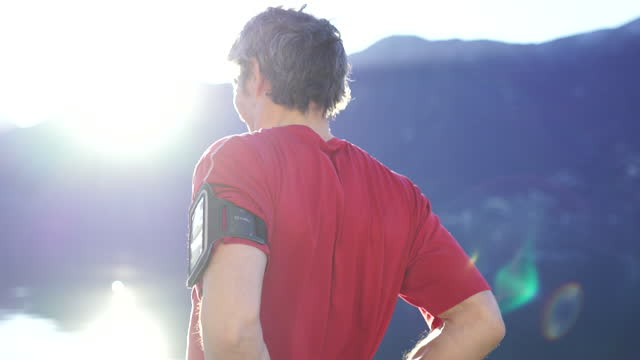man stretching before a jog near lake lugano - t shirt stock videos & royalty-free footage