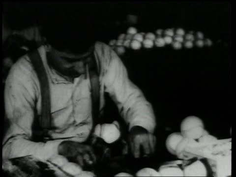 1920 montage man stretching leather over baseballs and stitching them together  - 1920 stock videos & royalty-free footage