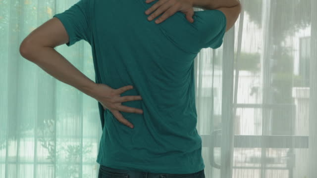 Man stretching the body from back pain feeling