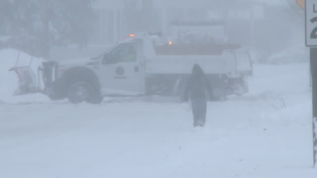 A man struggles to walk down the street in Freehold NJ in near whiteout conditions during the height of the Blizzard of 2016