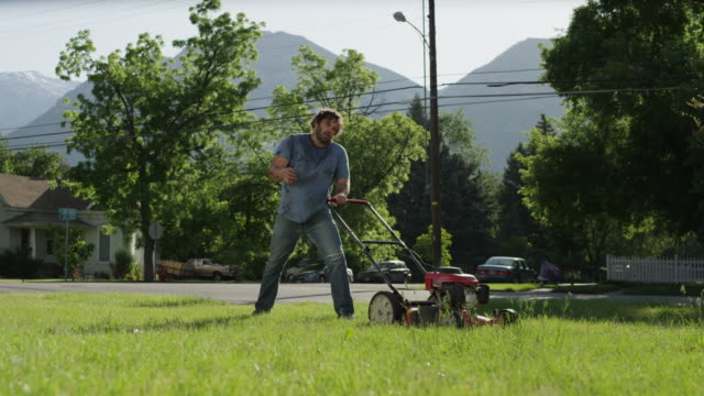ws man struggling with lawnmower / provo, utah, usa - lawn mower stock videos and b-roll footage