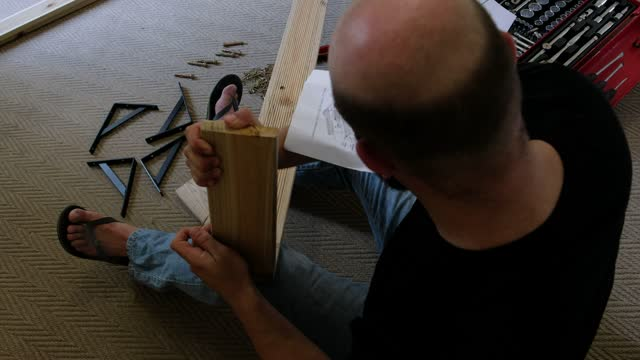 man struggling with woodworking project at home - one mid adult man only stock videos & royalty-free footage