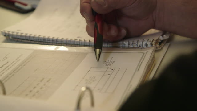 man studies diagrams in a book - pen stock videos & royalty-free footage