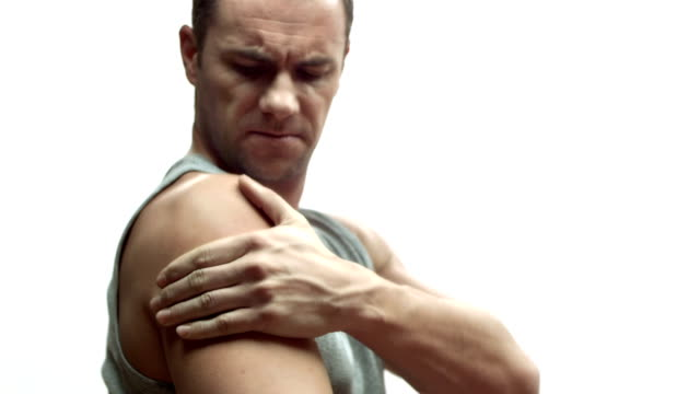 hd: man suffering arm pain - injured stock videos & royalty-free footage