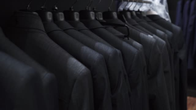 man suits at clothing store - suit stock videos & royalty-free footage