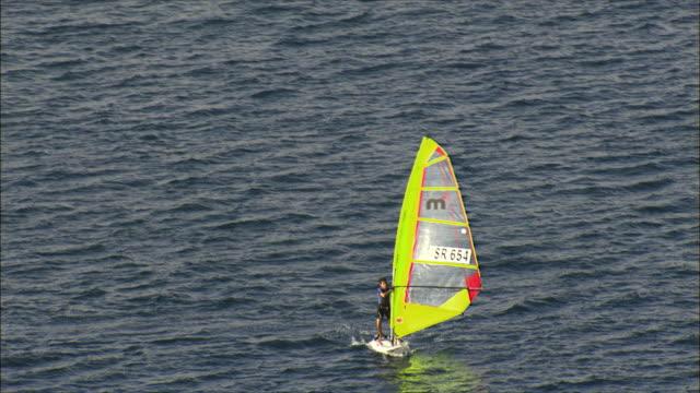 aerial ws ts man surfboarding, eilat, arava, israel - アラバ砂漠点の映像素材/bロール