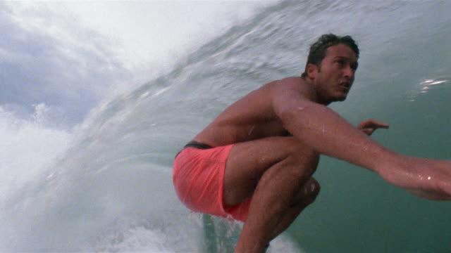 vídeos de stock, filmes e b-roll de ms man surfing in pipeline wave/ puerto escondido, mexico - pipeline wave