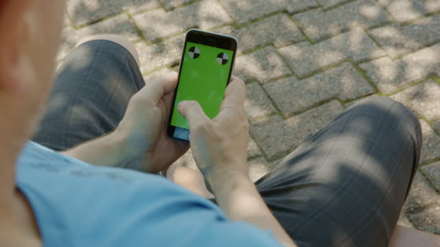 Man surfing texting chromakey green screen smartphone summer