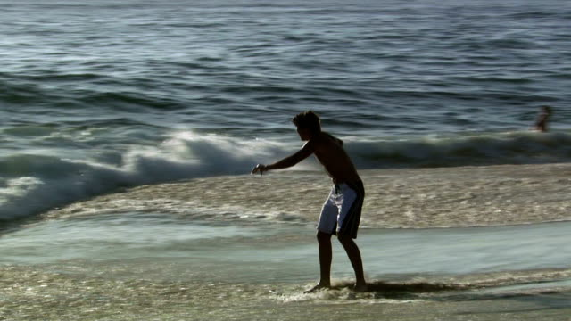 man surfing - skimboarding stock videos & royalty-free footage
