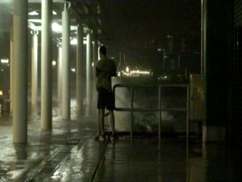 Man swamped by wave at waterfront, Typhoon Koppu, Hong Kong on night of 14th sept 2009. With Audio.