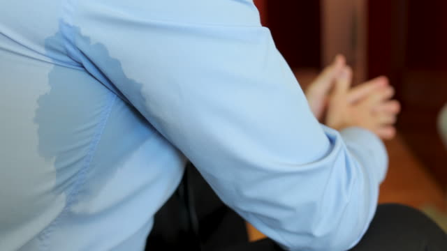man sweating under armpit during conversation - macchiato video stock e b–roll