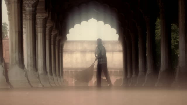 man sweeps under colonnade, agra, india - soft focus stock videos & royalty-free footage