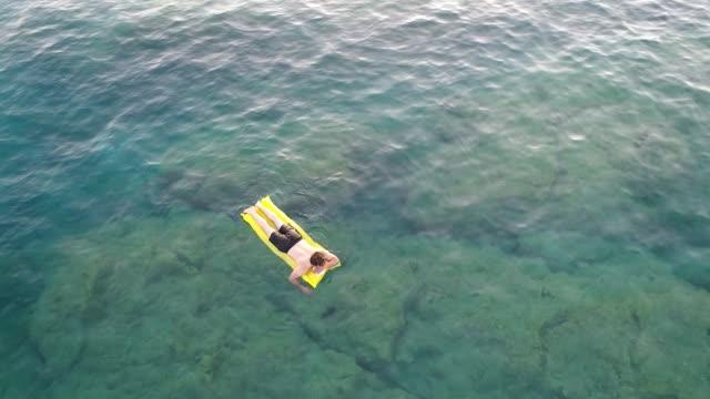 Man swimming and enjoying in sea water