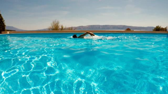 Man Swimming in a Resort Swimming Pool