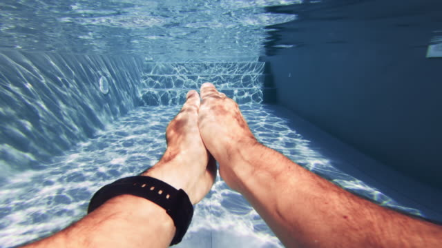 man swimming pov in a swimming pool: summer relax - wrist watch stock videos & royalty-free footage