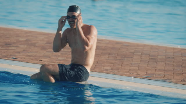 man swimming in pool - swimming cap stock videos and b-roll footage