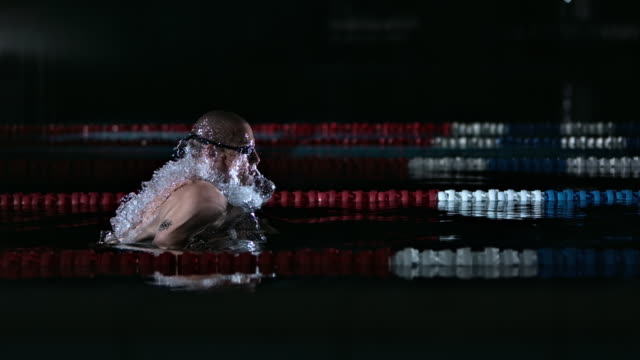 Man Swimming The Breaststroke