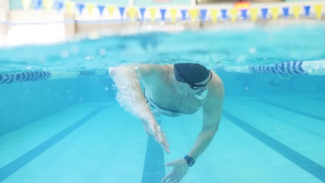 man swimming toward camera - swimming stock videos & royalty-free footage