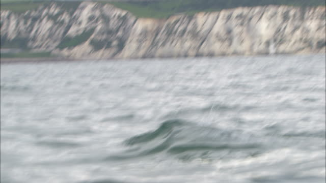 a man swims in the choppy water of the english channel. - english channel stock videos & royalty-free footage