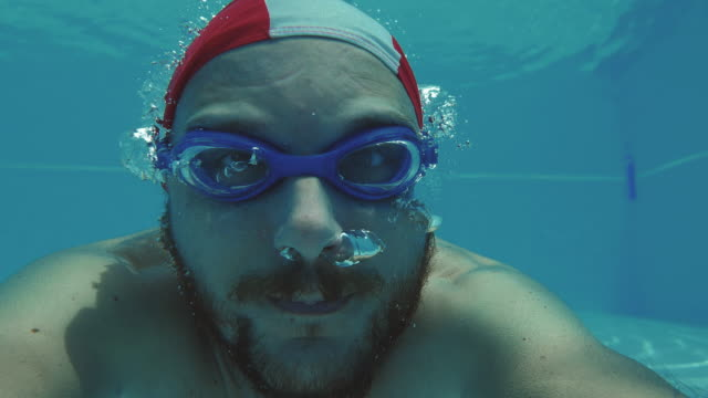 Man swims underwater