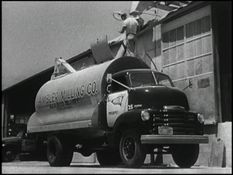 a man swings a big chute over a 1950 chevrolet grain truck and loads it with cargo then it hits the highway to deliver the goods you'll also see a... - chevrolet stock videos & royalty-free footage