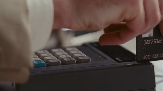 a man swipes a credit card through a card reader repeatedly. - punch card reader stock videos & royalty-free footage