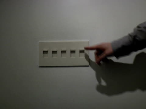 cu, man switching off lights in office, close-up of hand - switch stock videos & royalty-free footage