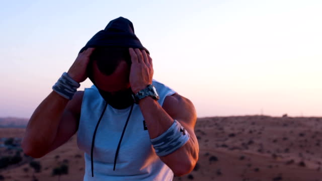 man take off his hood at the desert - pollution mask stock videos & royalty-free footage