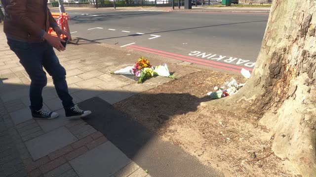 man takes a photo of the memorial plaque to murdered teenager stephen lawrence on april 22 in london, england. stephen lawrence was a black british... - murder stock videos & royalty-free footage