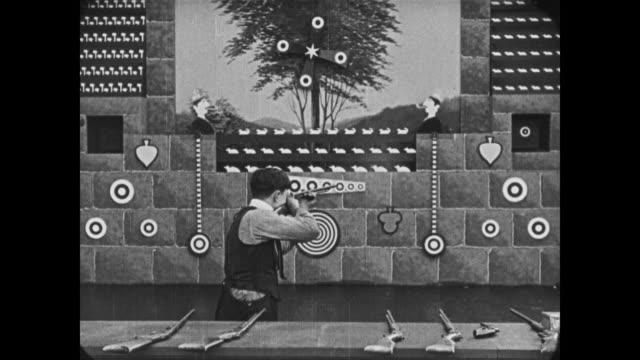 1921 man (buster keaton) takes job at shooting gallery - 1921 stock videos & royalty-free footage