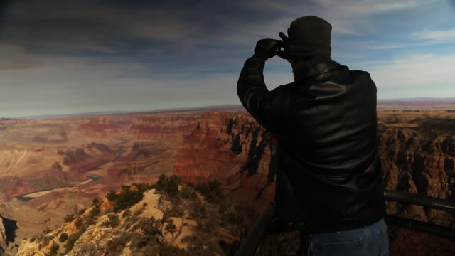 Man takes pictures of Grand Canyon