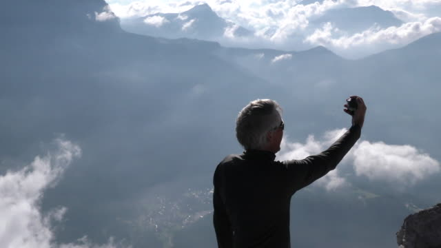 man takes selfie on mountain top - 60 64 years stock videos & royalty-free footage
