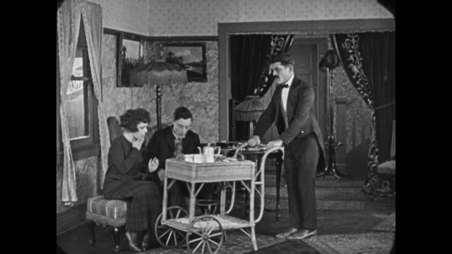 vídeos de stock, filmes e b-roll de 1921 man (buster keaton) takes tea with woman - bigode