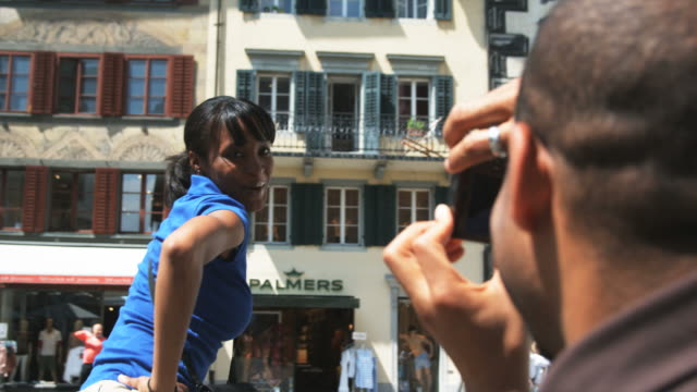 man taking a photo of a woman dancing - home movie stock videos & royalty-free footage