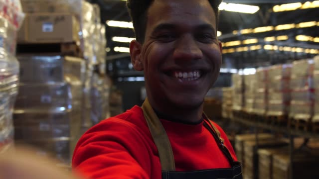 man taking a selfie at a warehouse - candid stock videos & royalty-free footage