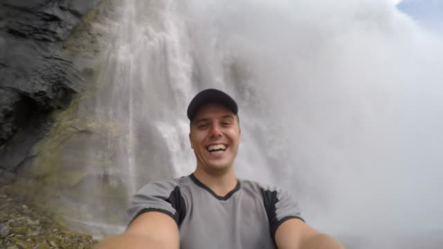 man taking a selfie near emperor falls waterfall robson river on the berg lake trail, mt. robson provincial park. - falling water stock videos & royalty-free footage