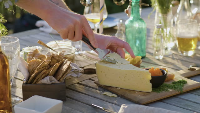 man taking cheese at midsummer dinner - dairy product stock videos & royalty-free footage