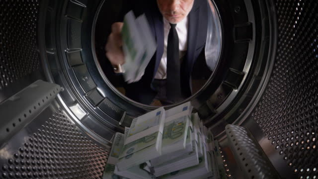 pov man taking euros out of a washing machine - greed stock videos and b-roll footage